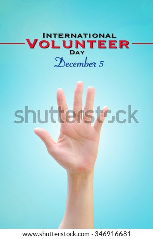 International Volunteer Day for Economic and Social Development on December 5: Woman human hand raising upward on vintage sky background showing vote, volunteering, participation, concept/ campaign    - stock photo