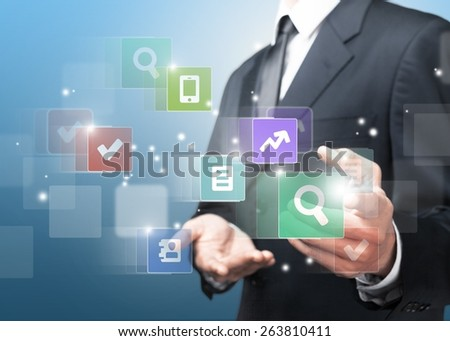 Internet. Businessman pressing application button on computer with touch screen - stock photo