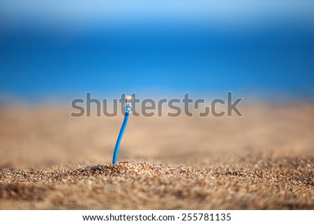 Internet cables on a beach - stock photo