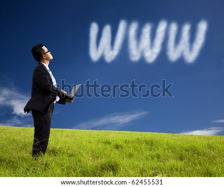 Internet cloud computing concept. businessman using laptop and watching internet cloud - stock photo
