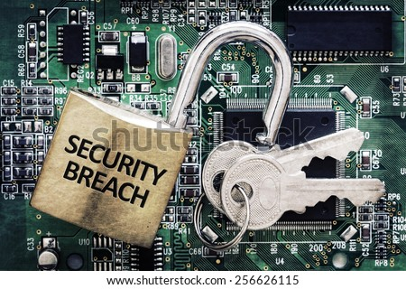 Internet computer security and network protection concept, padlock and key on circuit board - stock photo