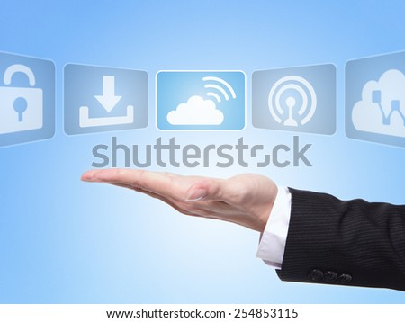 Internet concept , business man hand palm holding all kinds of icon about Internet with blue background - stock photo