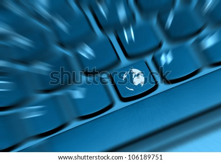 Internet Concept - Detail of Key With Globe Symbol on Keyboard