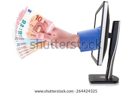 Internet earnings concept,hand with money coming out from computer monitor - stock photo