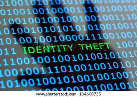 Internet identity theft on a digital tablet with reflection of hackers hand concept for online digital crime - stock photo