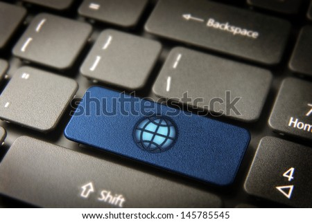 Internet key with Global icon on laptop keyboard. Included clipping path, so you can easily edit it. - stock photo