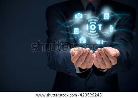 Internet of things (IoT) concept. Businessman offer IoT solution represented by symbol connected with icons of typical IoT - intelligent house, car, camera, watch, washing machine and cooker.