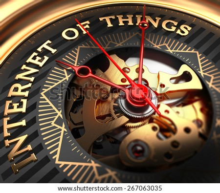 Internet of Things on Black-Golden Watch Face with Watch Mechanism. Full Frame Closeup. - stock photo