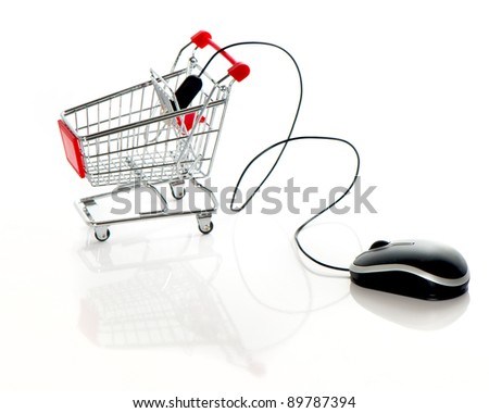 Internet online shopping concept. computer mouse and shopping cart - stock photo