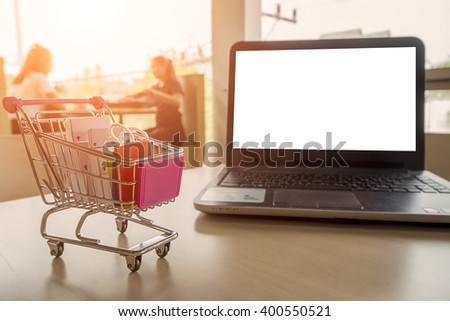 Internet online shopping concept with smartphone and shopping-cart.Vintage tone retro filter effect,soft focus(selective focus) - stock photo