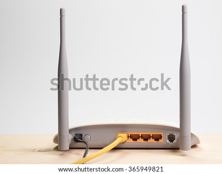 Internet Router ,Placed on a wooden table with a white background. - stock photo