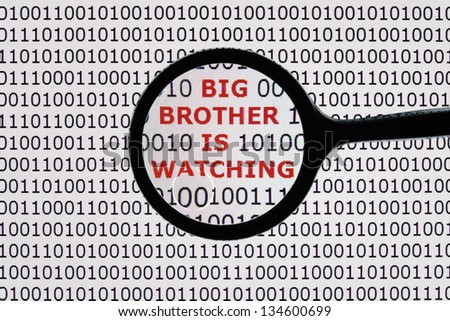 Internet security concept the words big brother is watching on a digital tablet screen with a magnifying glass - stock photo