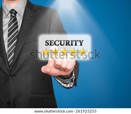 Internet security online business concept businessman pointing five stars security  services. Isolated on blue background. Stock Photo   - stock photo
