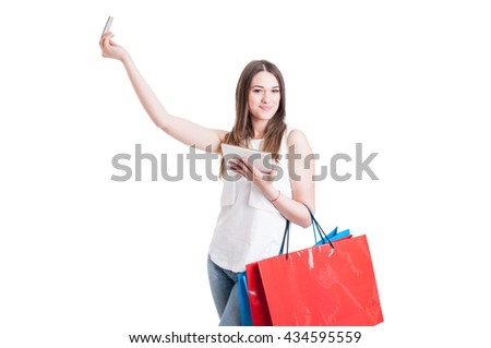 Internet shopping concept with beautiful shopper using credit or debit card and modern tablet isolated on white background - stock photo
