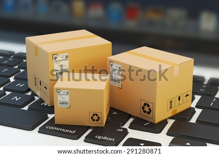 Internet shopping, online purchase, e-commerce and packages delivery concept, merchandise cardboard boxes on laptop keyboard - stock photo