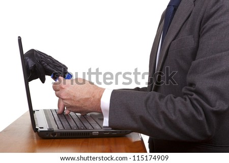 Internet theft - a gloved hand reaching out through a laptop screen to steal a credit card from a man. - stock photo