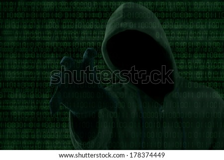 Internet theft - a hooded man grabbing a binary code - stock photo