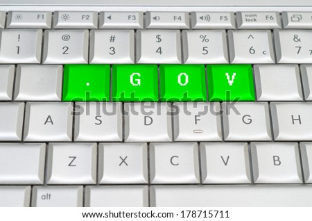 Internet top level domain .gov dot gov spelled on metallic keyboard - stock photo