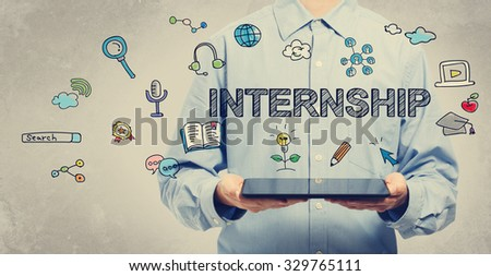 Internship concept with young man holding a tablet computer  - stock photo