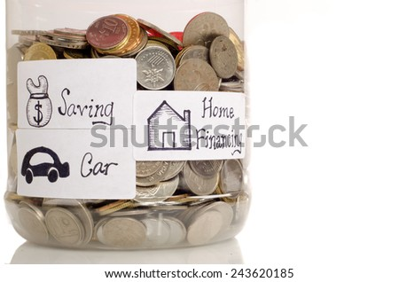 Interpretation of home financing, car saving and saving concept by using coin in the jar  - stock photo