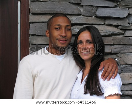 Interracial Biracial Couple Looking at You - stock photo
