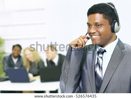 Interracial business team working at laptop in a modern office.