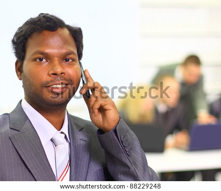 Interracial business team working at laptop in a modern office. - stock photo
