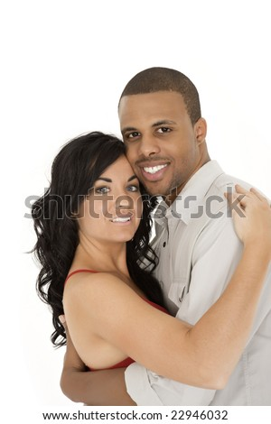 Interracial couple sharing and intimate moment - stock photo
