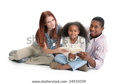 Interracial family, mom, dad, daughter, reading together. - stock photo