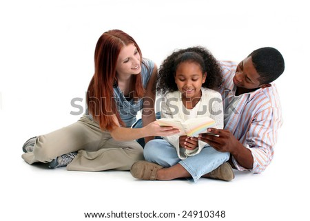 Interracial family, mom, dad, daughter, reading together over white. - stock photo