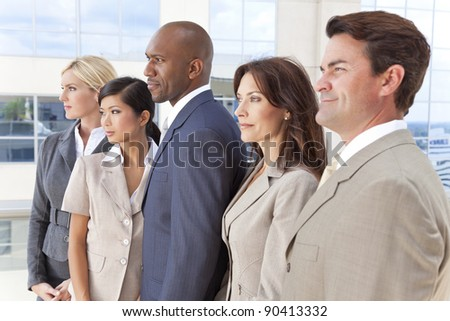 Interracial group of business men & women, businessmen and businesswomen team - stock photo