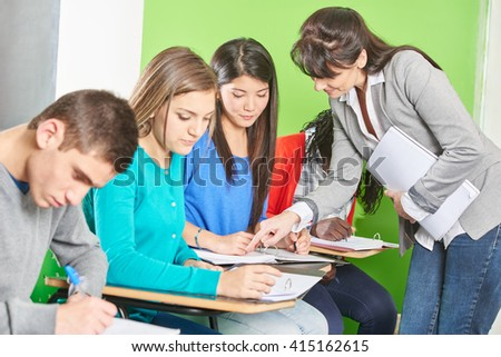 Interracial group of students presenting a test at their high school - stock photo