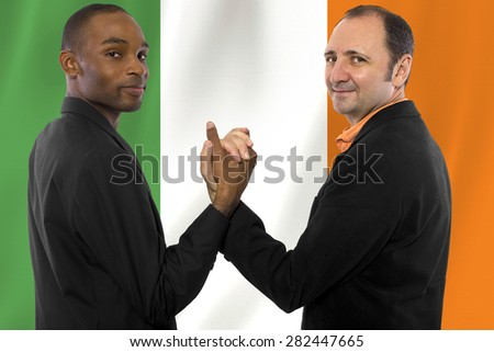 Interracial male gay couple celebrating legalization of same-sex marriage in Ireland - stock photo