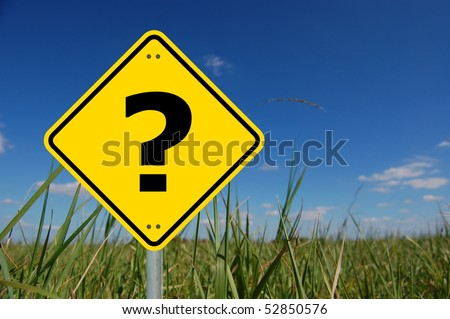 interrogation mark on yellow road sign and copyspace - stock photo