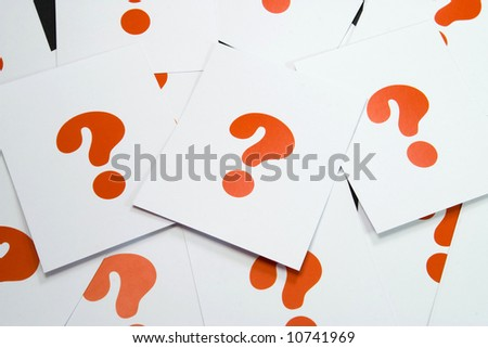 interrogation sign close-up in red and white paper - stock photo
