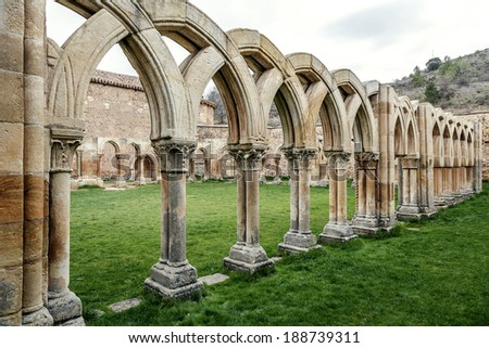 Intersecting arches in the courtyard of the Monastery of San Juan de Duero in Soria  - stock photo