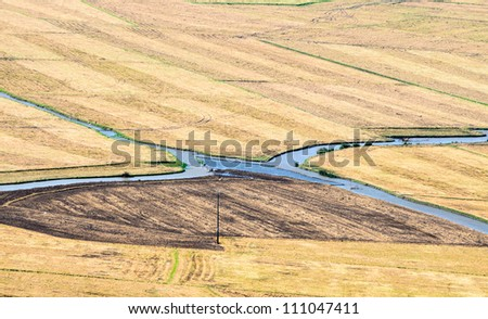 Intersection of two canals on farmland. Mekong Delta, An Giang, Vietnam - stock photo