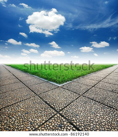 intersection way green grass cloudy blue sky to destination and green way to the future - stock photo