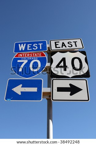 interstate 70 and 40 east highway signs, colorado - stock photo