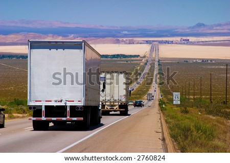 Interstate delivery trucks on a highway. - stock photo