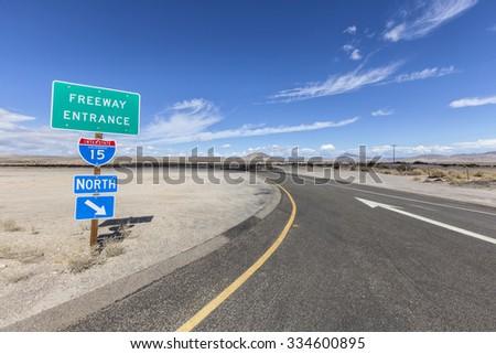 Interstate 15 desert freeway entrance in California's Mojave National Preserve.  - stock photo