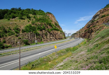 Interstate Highway 68, also called the National Freeway, running through Sideling Hill in the Allegheny Mountains, part of the Appalachian Mountain Range, in western Maryland - stock photo