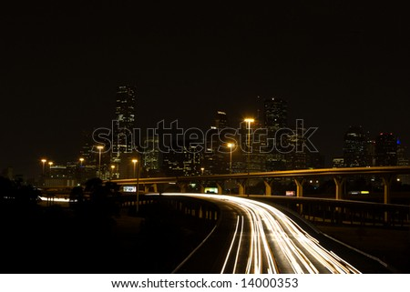 Interstate Highways and Downtown Houston at Night - stock photo