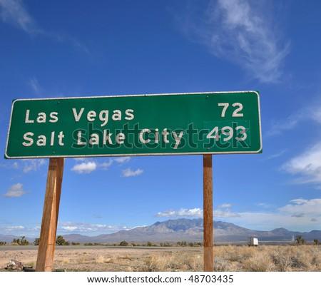 Interstate mileage marker showing ironic destinations. - stock photo