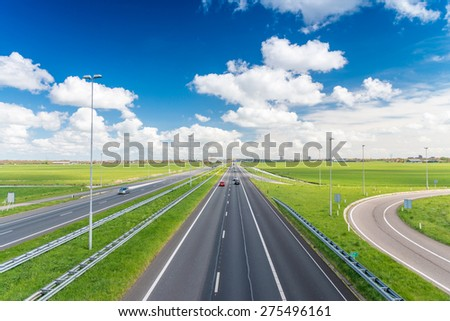 Interstate road crossing countryside. - stock photo