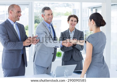 Interview panel shaking hands with applicant in the office - stock photo
