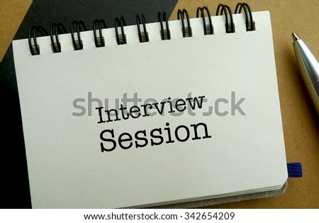 Interview session memo written on a notebook with pen - stock photo