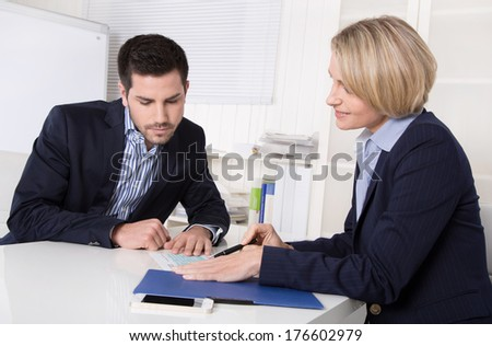Interview with manager and young attractive man at office. - stock photo