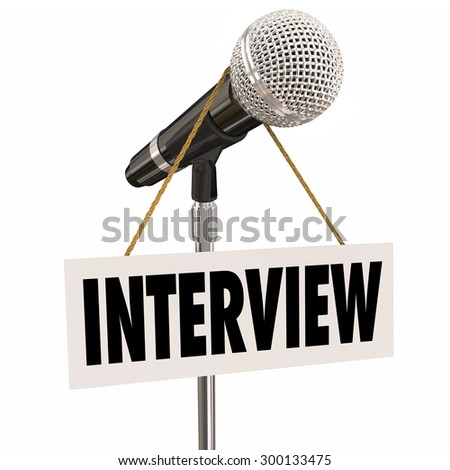Interview word on hanging sign on microphone to illustrate questions and answers for a speaker or panel discussion - stock photo