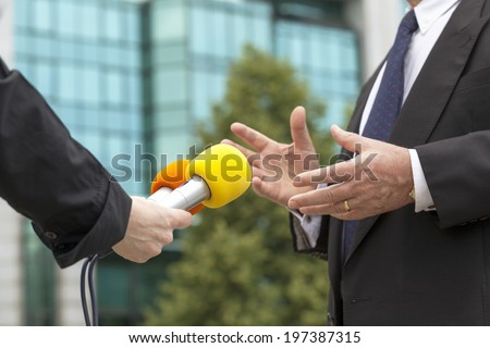 Interviewing business person - stock photo